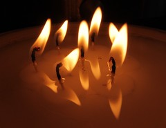 Dancing Flames (Michael Adedokun) Tags: reflection fire lights photo candles candle flames images