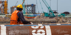 Man at work (Yan Lerval) Tags: menatwork back boat crane equipment gas helmet men oil onshore pile pipe platform protection rig sea yanlerval vungtau vietnam