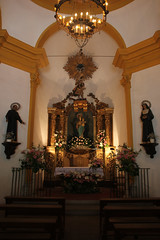 A Small Church in Tossa De Mar, Catalonia (johnjduncan) Tags: travel flowers tourism church statue spain candles catholic candle interior statues chapel indoor tourist resort chandelier inside ornate alter costabrava tossa tossademar cataluyna
