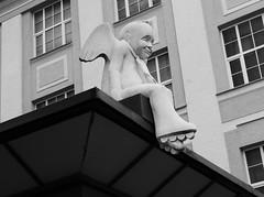 Angel with rollerblade (acid_nam) Tags: street streetphoto lumixlx100 thefarthergaze acidnam blackandwhite biancoenero bnw bn vilnius putto angelo pattiniarotelle pattini rollerblade angel