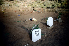 34-055 (ndpa / s. lundeen, archivist) Tags: nick dewolf nickdewolf color photographbynickdewolf 1970s 1973 film 35mm 34 reel34 utah southwestutah southwesternunitedstates ivins cemetery graveyard washingtoncounty indian nativeamerican grave graves tombstone tombstones marker markers gravemarker gravemarkers desert indiancemetery nativeamericancemetery shivwits paiute flowers shivwitspaiuteindiancemetery shivwitspaiute reservation indianreservation shivwitsindianreservation bushead granpabushead oldmanbushead granpaoldmanbushead bushhead