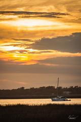 Sunset at Low Tide (Benjamin Coy) Tags: sunset sun water clouds sailboat docks boats evening daylight dock boating marsh lowtide fading saltwater gardencity murrellsinlet
