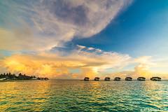 Cloudy Ends (Mystrimus) Tags: sunset travelling nikon resort maldives jumeirah 14mm watervilla rokinon vittaveli