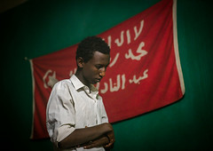 Sufi man worshipper in front of islamic red flag, Harari region, Harar, Ethiopia (Eric Lafforgue) Tags: africa travel red portrait people man color horizontal outdoors photography day adult african flag muslim islam faith religion indoor unescoworldheritagesite unesco indoors spirituality ethiopia sufi sufism worshipper oneperson hornofafrica ethiopian harrar eastafrica placeofworship harar abyssinia arabiccalligraphy traditionalclothing harari oromo onemanonly 1people harer harariregion hararjugol harergeprovince harergey ethio163016