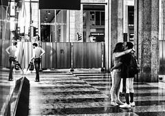Who did first kiss suggest? (Petricor Photography) Tags: milan milano street photography canonpersonalconnection candid kiss lovers love rain black white blackandwhite and