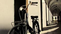 Sabato in carrugio ... (Augusta Onida) Tags: street light italy bike silhouette strada italia gallery liguria bici chiavari luce portico bicicletta carrugio