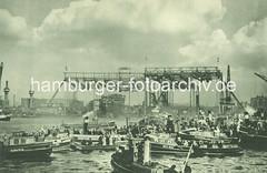 X89431_16_17 Stapellauf der Cap Arcona in Hamburg - im Hintergrund die Helgen der Werft Blohm Voss und der Schnelldampfer; Barkassen mit Schaulustigen auf der Elbe. (christoph_bellin) Tags: fotos hamburger hafen bilder entwicklung geschichte alte werft historische fotoarchiv bootsbau schiffswerft werftarbeiter