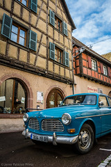 Volvo in Eguisheim (Javier Palacios Prieto) Tags: auto blue sky cloud tower classic church car azul volvo kirche himmel wolke coche alsace blau turm nube fachwerk fachwerkhaus eguisheim