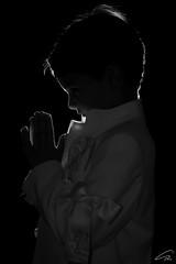 Holy Communion (glank27) Tags: lighting boy canon photography catholic peace child flash pray holy christianity f18 rim communion silhoutte ef50mm yongnuo eos70d