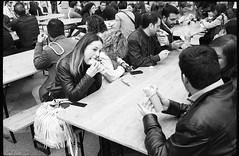 (Hunger Pangs) (Robbie McIntosh) Tags: leicam2 leica m2 rangefinder streetphotography 35mm film pellicola analog analogue negative leicam summicron analogico leicasummicron35mmf20iv blackandwhite bw biancoenero bn monochrome argentique summicron35mmf20iv autaut dyi selfdeveloped filmisnotdead leicasummicron35mmf2i strangers candid ilfordfp4 ilford fp4 guessexposure sunny16 nometering arsimagofd arsimagofddeveloper woman internationalstreetfoodfestival streetfood fingerfood blonde beer beers burger pork chips