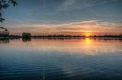 reflected (stevefge (away travelling)) Tags: sunset sunlight water netherlands reflections sundown lakes nederland beuningen weurt grindgat nederlandvandaag reflectyourworld