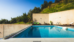 Chillin by the pool (Nicola Pezzoli) Tags: travel blue sea summer house architecture landscape golden king apartments resort swimmingpool greece luxury skiathos sku