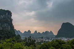 Sunset Over Guilin (rebecca_e_johnson) Tags: china city trees sunset sky sun mountain mountains nature skyline clouds sunrise outside outdoors town guilin walk hill