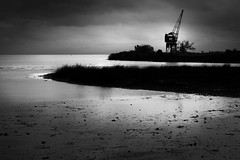 Old Crane on the river (hzeta) Tags: ocean old light sea sky bw white black blanco luz water silhouette rio clouds port river puerto mar agua y crane negro vieja bn cielo nubes silueta grua oceano