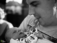 Hey Dad (Stuart_Byles) Tags: blackandwhite bw baby proud dad hand pride newborn welcome connection touching