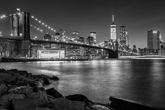 rocks (Louis Quattrini) Tags: newyorkcity longexposure nightphotography blackandwhite brooklyn cityscapes skylines brooklynbridge eastriver nyskyline empirestate bigapple freedomtower