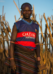 Hamer tribe man with paris saint germain football shirt, Omo valley, Turmi, Ethiopia (Eric Lafforgue) Tags: barcelona africa portrait people color men vertical shirt hair outdoors photography necklace football colorful day adult african culture tribal blackpeople omovalley ethiopia tribe ethnic hairstyle oneperson hamer hornofafrica ethnology eastafrica psg abyssinia tribesman onepersononly qatarairways realpeople blackskin lookingatcamera onemanonly waistup turmi africanethnicity 1people indigenousculture ethnicgroup oneadult blackethnicity modernityandtradition ethiopianethnicity ethio161509
