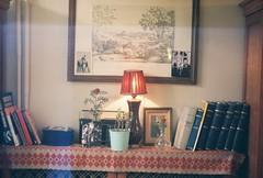 indeed. (artsmavi) Tags: analog corner coffeeshop istanbul bookshelf zenit analogue