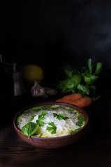 Thai chicken noodle soup, dark moody still life (breamchub) Tags: wood stilllife food color green bird chicken vegetables yellow vertical dinner dark table thailand photography soup ginger photo spring lemon healthy asia moody dish eating spice bowl pasta meat east gourmet thai meal carrot garlic basil noodles products temperature parsley cilantro cultures province sweetcorn vermicelli alternatives foodphotography