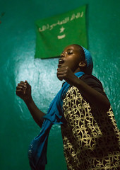 Sufi teenage girl goes into a trance during a ceremony, Harari region, Harar, Ethiopia (Eric Lafforgue) Tags: world africa travel people color green girl vertical night religious outdoors togetherness dance clothing worship veiled singing dancing african flag muslim islam religion praying group performance performing ceremony dancer unescoworldheritagesite celebration indoors event teenager spirituality ethiopia sufi sufism trance hornofafrica chanting eastafrica harar abyssinia harari harariregion ethio163059