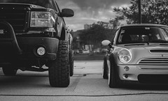 Hold your own. (RayBanzPhotography) Tags: blackandwhite bw cars monochrome 35mm prime nikon fuji rj opposite bokeh low mini x chevy cooper f18 boke carshow matte stance primelens xe1 f18g xmount