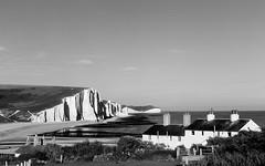 Coastguard cottages (Adeypoos) Tags: sea sky bw sussex coast waves background coastline seafront englishchannel cuckmerehaven sussexcoast coastguardcottages canoneos6d adrianpollardphotography