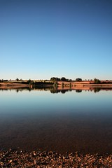 At the Water's Edge (Andrew.King) Tags: trees portrait sky lake colour reflection water composition evening saturated rocks warm tripod bank reservoir clear nd bouy filters coking pitsford