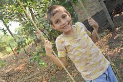 Inocence (tSukkiePink) Tags: ranch boy color mxico youth children tabasco sonrisa nio risa pequeo rancho chicos alegra columpio