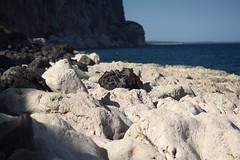 Black Rock (oliko2) Tags: black rock beach stone calagonone italy sardinia nikond7100 85mmf18 evening coast mountains sea water landscape light shadow white