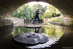 Jump! (Tris1972 (tmorphewimages.co.uk)) Tags: steppingstones millstone bridge water boy jump jumping cambridge uk unitedkingdom england fun wideangle canon 5diii brick brickwork structure autumn autumnal arch reflection trees cherryhintonhall stone steps waterfall leaves canonef24mmf14liiusm low