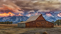 Moulton Barn At Sunrise On A Stormy Morning In the Teton Range (glness) Tags: moultonbarn mormonrow grandtetons grandtetonnationalpark sunrise storm stormy barn snakerivervalley dawn wyoming jacksonhole historicdistrict homesteaders ©gregness mountains grandeur antelopeflats autumn fall