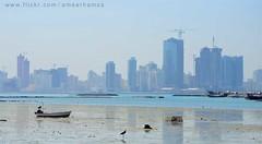 Manama city, Middle East (Ameer Hamza) Tags: sea sunlight buildings landscape boat bahrain construction view sharp clear boating activity manama arabiansea landscapephotography ameerhamzaadhia ameerhamzaphotography gettyimagesmiddleeast