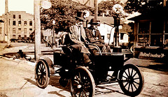 Anson McNish driving an electric car, Fonda, New York (JFGryphon) Tags: mysterycar fondanewyork cayaduttastreet fondagloveliningcompany ansonmcnish