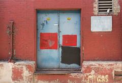 Calming Doors (BradPerkins) Tags: door old city red chicago brick metal graffiti alley rust colorful paint loop rusty hidden faded decrepit smalldoor urbanlandscape fadedsign metaldoor chicagoist urbanbeauty rusteddoor