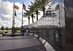 Veterans Memorial Wall (Francine Schumpert) Tags: clouds reflections americanflag palmtrees cloudysky supportourtroops jacksonvillefl veteransmemorialwall adayofremembrance memorialday2015
