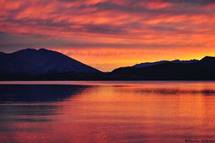 The Day the Night Caught Fire (Kevin_Jeffries) Tags: sunset red sky mountain lake nature silhouette fire flickr glow wanaka lakewanaka firesky flickrtoday glendhubay kevinjeffries