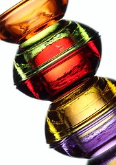 Jewels (Karen_Chappell) Tags: red stilllife orange white green glass yellow colours purple bright multicoloured stack colourful tilt