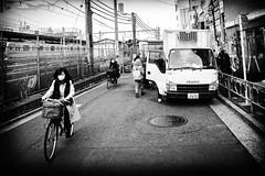 Activits (www.danbouteiller.com) Tags: japan japon japanese japonais city ville people urban tokyo nakano photo de rue street streetlife streetshot streets cityscape canon canon5d 5d 5d2 5dm2 5dmk2 samyang samyang14mm 14mm bike velo femme woman truck camion monochrome black white noir et blanc bw nb noiretblanc blackwhite blackandwhite