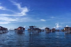 Fishing village (Syahrel Azha Hashim) Tags: ocean poverty travel houses light vacation holiday detail building colors beautiful architecture clouds 35mm buildings prime wooden community nikon colorful dof village getaway sony details poor naturallight bluesky nopeople malaysia handheld local shallow simple dramaticsky residential sabah unfortunate clearsky fishingvillage floatingvillage simplelife seagypsies woodenhouses a7ii colorimage semporna housesonstilts d300s bodgayaisland sonya7 syahrel ilce7m2