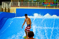 Flow-Rider Margaritaville (LarryJay99 ) Tags: blue man male men guy water lines pits fence surf pattern nipples arms legs surfer guys dude hollywood splash waterfeature dudes seashore blackmale armpits sportswear boardsports wavers flowrider happyfencefriday 52260mm
