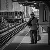 Getting Around Alright (Carl's Captures) Tags: quincystation trainstation platform cta chicagotransitauthority ltrain eltrain masstransit transportation traveler man hat armsling rapidtransit journey waiting candid portrait cityscape story cinematic baggage luggage chicagoillinois cityofchicago urban tracks downtown theloop thewindycity chitown squarecrop monochrome blackandwhite bag strap nikond5100 tamron18270 lightroom5 june saturdaymorning telephotocompression overhang architecture disabled disability passenger curve corner approaching shadows anticipation grain grainy lowlight chicagoan travel overcast rainy elevated