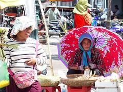 Groundnut seller (bindubaba) Tags: cambodia phnompenh streetsellers umbrellas streetlife