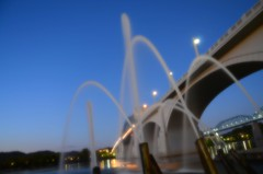Aquarium Fountains - Twilight (Roland 22) Tags: blue sky white chattanooga water reflections lights evening twilight flickr glow tn dusk pov jets northshore lamps walnutstreetbridge tennesseeriver coolidgepark marketstreetbridge palebluesky aquariumfountains