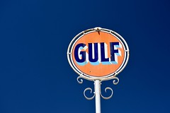 Gulf, Plate 2 (Joanne Dale) Tags: orange white sign metal vintage typography gulf outdoor gasstation servicestation joannedale nikond7200 thatisoneseriousbluesky
