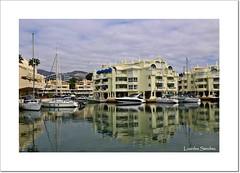 Reflejos en Puerto Marina (Lourdes S.C.) Tags: andaluca agua barcos cielo nubes reflejos puertos viviendas puertomarina provinciademlaga benalmdenacosta puertosdeportivos
