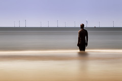 Visiting Another Place (Julian Pett) Tags: crosby beach liverpool another place anthony gormley statue sea sand mersey estuary waves long exposure art wind turbine windmill antony