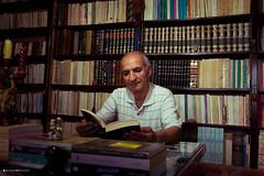 """ This is my kingdom.. ""  Fouad Kahel - Poet (wisam.mousfi) Tags: portrait book bookshelf poet tradition"