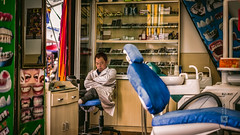 Tibet, candid shot of a dentist taking a nap in his office (Lhasa, China), 06-2016, 08 (Vlad Meytin, vladsm.com) (Vlad Meytin | Instagram: vmwelt) Tags: pictures china street sleeping summer photography office asia candid chinese streetphotography tibet doctor tired local resting  lhasa lunchbreak dentaloffice    chengguan stomatology dantist   khimporiumco meytin vladmeytin vladsm vladsmcom