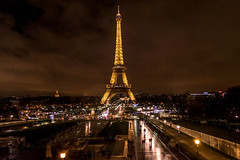 Eiffeltower at night (jonathan gaier) Tags: street light paris france wet rain night clouds dark licht frankreich nacht no strasse tripod eiffeltower wolken eiffel eiffelturm regen nass strase