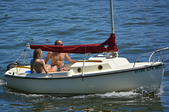 Trading Places (swong95765) Tags: woman guy water weather sailboat river sailing power gal recreation outboard bathingsuits